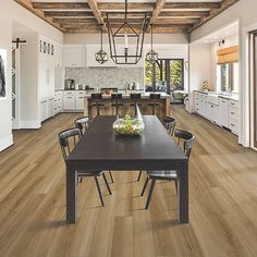 Brown, medium wood-look flooring.  Pergo Extreme Wood Originals in Sand Bar