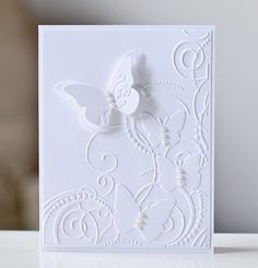 Love the white on white..I think I have this embossing folder...