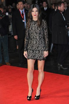 Sandra Bullock: Who said black was boring? Sandra Bullock was anything but for the London premiere of Gravity, picking a a long-sleeved, lace Stella McCartney mini dress with Charlotte Olympia heels and accessories by Martin Katz.