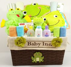 This Toadally Froggy basket is filled with baby bath towels, receiving blankets, bibs and more all with a fantastic frog theme! The gender neutral color scheme makes it a great for a baby shower gift