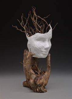 """My piece was inspired by the idea that there are two different sides to a story.  Using movement, texture, and form in my piece, I rested two paper mâché mannequin faces together in an interesting piece of wood. Realistic branches were added, representing that at the root of every lie there is truth."""