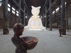 Kara Walker, A Subtlety, or the Marvelous Sugar Baby, an Homage to the unpaid and overworked Artisans who have refined our Sweet tastes from the cane fields to the Kitchens of the New World on the Occasion of the demolition of the Domino Sugar Refining Plant, 2014. Artwork © Kara Walker, courtesy of Sikkema Jenkins & Co., New York. Photo by Jason Wyche. Courtesy of Prestel Publishing.