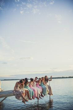 "We are totally obsessing over this amazing ""bridesmaid"" picture out the dock!!! The colors are just gorgeous! Image: Bonnallie Brodeur Photographe"