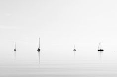 Minimalist Sailboats - Four yachts on an incredibly calm day.