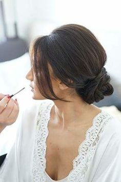 There's nothing quite like being pampered, right? Especially on your wedding day. Make sure your photographer gets the shots of you getting your hair and makeup done.