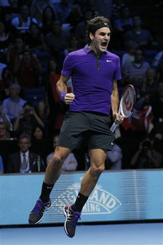 Previous Transmission reference: DDD460EAC12D413F9D33BA82355DD203      1  Roger Federer of Switzerland celebrates his win against Andy Murray of Britain at the end of their ATP World Tour Finals singles semifinal tennis match at the O2 Arena in London, Sunday, Nov. 11, 2012. (AP Photo/Sang Tan)