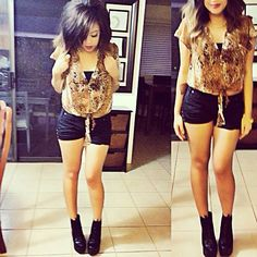 Ferocious animal print top and itty bitty black shorts
