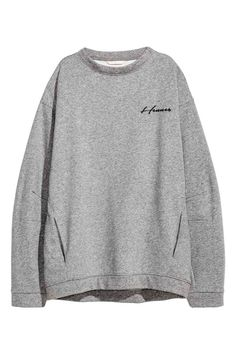 Oversized sweatshirt: Oversized sweatshirt with text embroidery on the front, a wide neckline, dropped shoulders, long, wide sleeves and concealed side pockets. Soft brushed inside.
