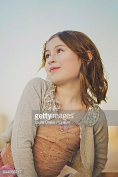 Stock Photo : Front View Of Cute Girl Against Sky