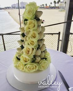 Strawberry towers are the next big thing. Decadent Double dipped chocolate strawberries with a cascading display of white roses.