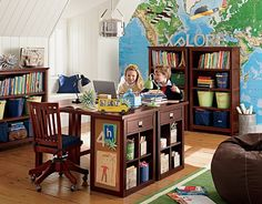 I love this pottery barn school desk... Especially love the fact they are using the middle of a room and not just walls...mmm, but why cover that map wall up? lol...