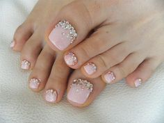 Attaching crystals or tiny stones atop a shimmery pink base infuses your pedicure with glam power.