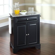 Cambridge Solid Black Granite Top Portable Kitchen Island in Black Finish - Crosley of solid hardwood and wood veneers, this kitchen island is designed for longevity. The beautiful raised panel doors and drawer front provide the ult Kitchen Island With Granite Top, Kitchen Island Cart, Granite Tops, Black Granite, Kitchen Islands, Kitchen Carts, Kitchen Ideas, Granite Kitchen, Kitchen Tips