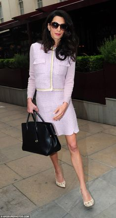 Chic as ever: Amal Clooney was dressed to impress in a lilac skirt and a matching jacket a...