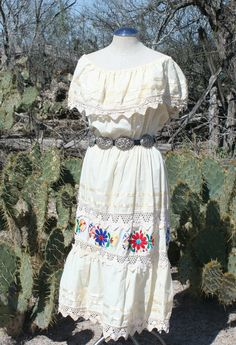 She Talks Dirty In Spanish - Light Airy Comfortable Mexican Dress with Colorful Floral Embroidery - 1980s Vintage Dress. $34.00, via Etsy.