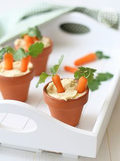 Carrots in Hummus in a plant holder! :D cute!