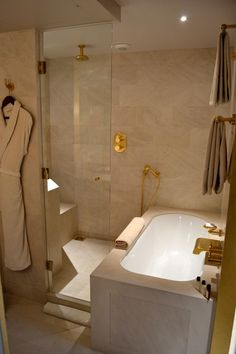 What a clever idea for a tub/shower combo! (photo from The Londoner: Paris Day One blog post)