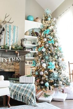 Amazing in Aqua! Christmas Tree - Fresh winter snow scene with birch trees on the mantle and the tree is a Turquoise Winter Wonderland. Beautiful Decorating Idea.