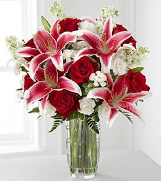 Perfect! Stargazer lilies and roses. Bridesmaids bouquet