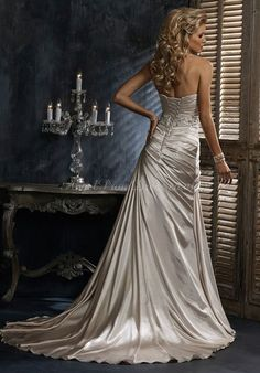 Silvery wedding dress. Love the lacing, underbust detail, fabric choice