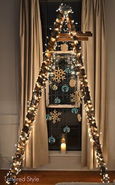 ladder tree... awesome! Could leave out outside for ease of access if a bulb burns out on the top of the house display.