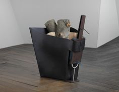 A Stylish Firewood Basket And A Bellows Set In Wenge and Leather | Shelterness