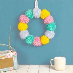 Are you interested in our Pom Pom Easter Wreath? With our Spring Pastel Wreath for your Door you need look no further. Pom Pom Wreath, Pom Poms, Craft Stick Crafts, Diy Crafts, Craft Ideas, Easter Crafts For Kids, Easter Stuff, Easter Art, Summer Crafts