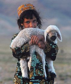 salamalaikum: An Afghan girl with her sheep, outside the city of Herat. By Aref Karimi