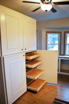 Slide-out shelves add a surplus of storage in this reader's DIY kitchen makeover.   thisoldhouse.com