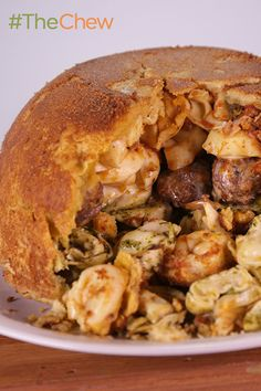 Craving something cheesy and delicious? Look no further than Mario Batali's outrageously tasty Tortellini and Meatball Timpano! Recipe: