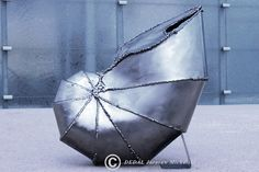 Made with mig welder and metal scrap. Inspired by taxidermy. Brutalist welds make shell more expressive. Weekend welding project for modern interior.