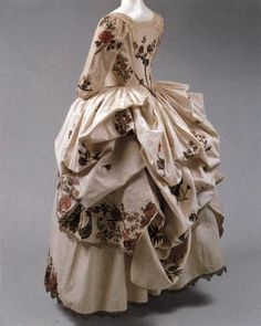 Rear view of Robe a la Polonaise, 1780, cream linen, gold embroidery, metal. Metropolitan Museum of Art
