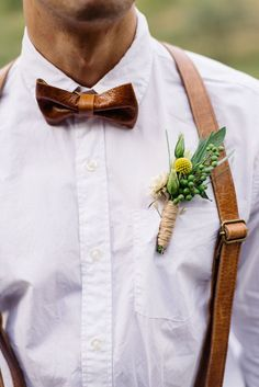 Simple boutonniere with lisianthus, billy buttons and sage ... Venue: Fines Creek Farm Florals: Flourish Flower Farm  Hair: Tru Salon  Cake: Formations of Mental Objects  Plates: Motyl Pottery  Accessories: Fox & Beau  Table: Mike & Mike's Rustic and Reclaimed Furniture  Paper Goods: Ellolovey  Photos: Joy Light Photography  Video: Evergreen Era Films