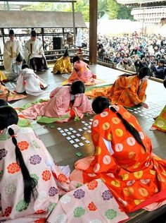 "23 ladies in heian outfits enjoying a card game of uta-garuta in Yasaka shrine, Kyoto. 03.12.13 . This game is traditionally played during the New Year's holidays. There are 100 cards in the deck, and each has a poem written on it - from the ""Hyakunin Isshu"" (""one hundred people, one poem each"") anthology. 平安装束で華麗に「かるた始め」 京都・八坂神社"