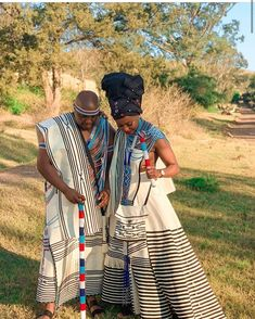TRADITIONAL XHOSA ATTIRES,The most interesting thing about fashion is how you can make the most casual outfit look splendid and fitting for all occasions Traditional Wedding Attire, Traditional Gowns, Xhosa Attire, African Wedding Attire, African Traditional Wedding, South African Weddings, Dress Attire, Fashion Couple, Africa Fashion