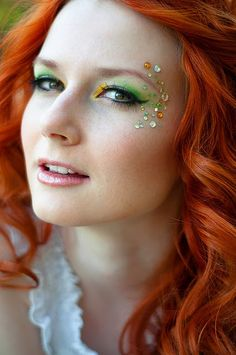 Colorful yellow and green eye shadow accented with multi-color gems...  perfect colors to accent red hair.