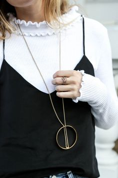 90s-inspired look on blogger, Lucy Williams; wearing the Halo Pendant.
