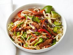 Pork and Noodle Stir-Fry from FoodNetwork.com  I want to make this. Looks like a great basic recipe, but will add more spices.  The reviews said it needed more flavor.