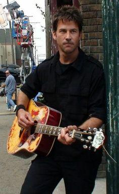 Joe Flanigan. I bet he's skate boarding while playing guitar... ;)