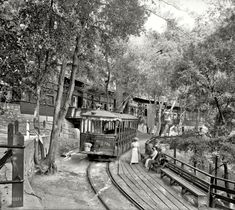 """Mount Lowe, California, circa 1913. """"Electric car at Ye Alpine Tavern, Mount Lowe Railway."""" This Swiss-style chalet in the San Gabriel Mountains was the upper terminus (elev. 5,000 feet) of an 1890s scenic and incline railway that started in Altadena, with streetcar connections to the main terminal at the Pacific Electric Building in Los Angeles. The railway and associated resorts, including the 70-room Echo Mountain House ,obliterated by fire and flood"""
