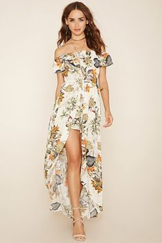A woven floral print skort romper with off-the-shoulder short sleeves, an elasticized neckline and waist, and a maxi skirt overlay.
