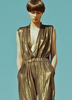 metallic gold, jumpsuit, cinched, bowl cut, deep v