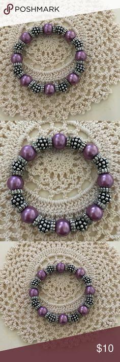 Dressbarn elastic bracelet Dressbarn silver colored, black and purple elastic bracelet. Elegant. Can be worn day or night! Dress Barn Jewelry Bracelets