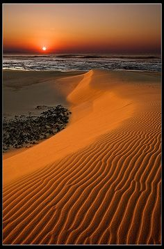 Sunrise over a sand dune at Christmas Rock in the Eastern Cape of South Africa by Jon Reid