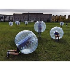"""Guys at a bachelor's party in Oslo, Norway, gearing up for a game of Bubble Football."" Wut?! O.o"