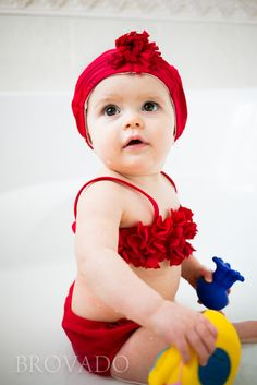 Baby in a bikini, cute as a button... complete with matching vintage swim cap!