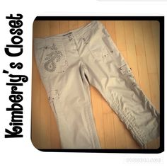 ✨INC embellished capri pants INC khaki capri pants with rhinestone accents and buttons on pockets, embroidered details on front right pocket, side left pocket, and back left pocket.  Drawstrings in legs to cinch for a shorter look.  97% cotton, 3% spandex.  Machine washable.  Gently used - very good condition (no stains, marks, tears, etc).  The perfect summer pant! INC International Concepts Pants Capris
