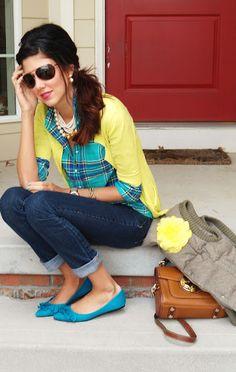 Plaid shirt, yellow cardigan, pearls, pointy flats