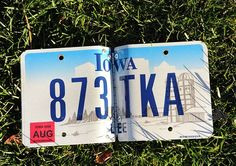 Photo album made from an Iowa license plate. Old License Plates, License Plate Art, Old Plates, Iowa State, Dream Catchers, Repurposed, Numbers, Recycling, Clock