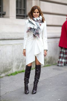 Christine Centenera in a elegant, white, ruffled coat, oversized scarf, knee length boots. Very cool! Paris Fashion Week, Street style.